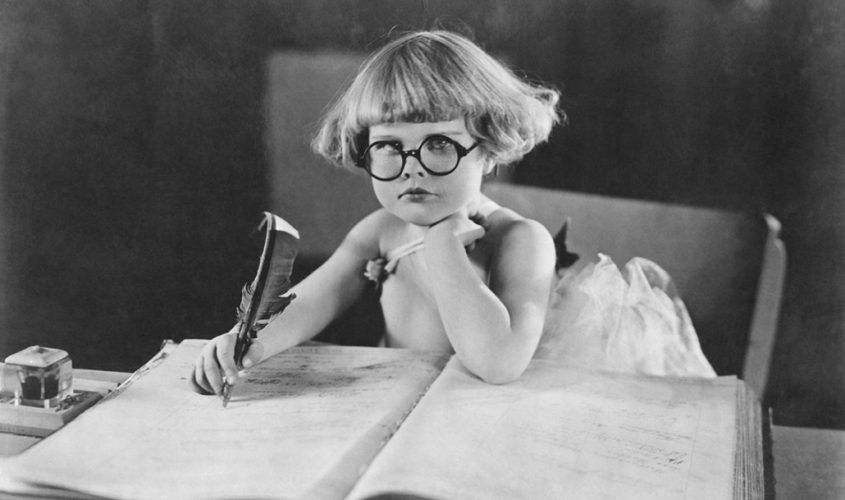 Photo of girl in glasses writing