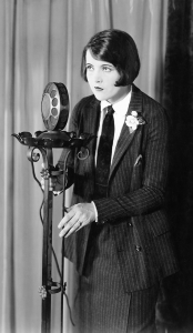 Photo of b&w woman at microphone